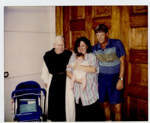 Fr. Joachim Tierney, O.C.S.O., Lori, husband John, and baby Jessie.  Fr. Joachim, a noted spiritual director was instrumental in assisting the Disciples of Mercy during their discernment process.